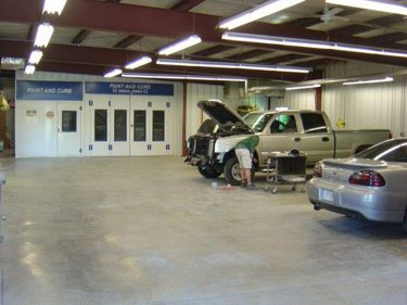 51 Auto Body Shop Interior with Employee working on pickup